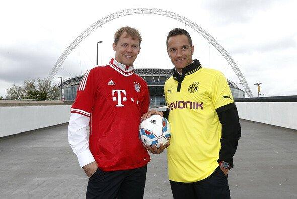 Gipfeltreffen in Wembley: Timo Scheider unterstützt Borussia Dortmund - Mattias Ekström den FC Bayern - Foto: Audi