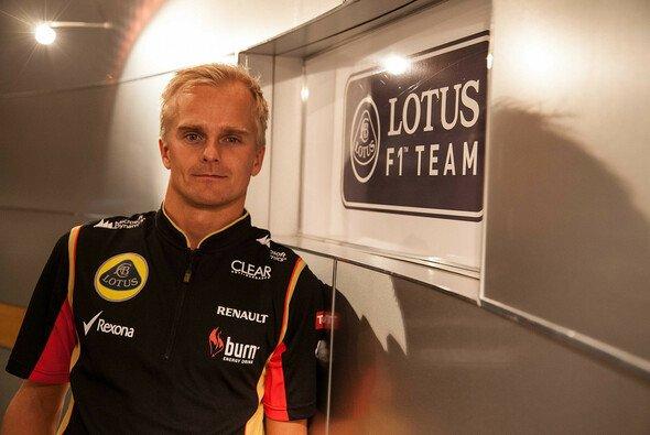 Heikki Kovalainen wechselt Grün gegen Schwarz-Gold - Foto: Lotus