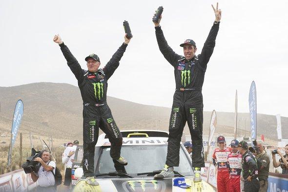 Michel Perin und Nani Roma feiern ihren Dakar-Sieg