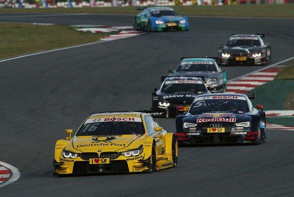 Timo Glock vs. Mattias Ekström: Nach dem Rennen ging es rund - Foto: BMW AG