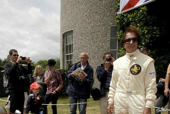 Emerson Fittipaldi neben dem Lotus 72, der bis heute als das erfolgreichste Formel-1-Auto gilt